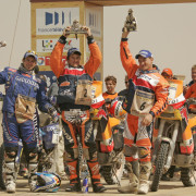 ccr-dakar-2006-bike-category-podium-winner-marc-coma-celebrates-with-cyril-despres-and-gio-2